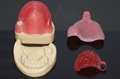 Figure 20. Mock up of cobalt chromium base in pattern resin to try in so that patient can assess where there will be visible metal in final denture.